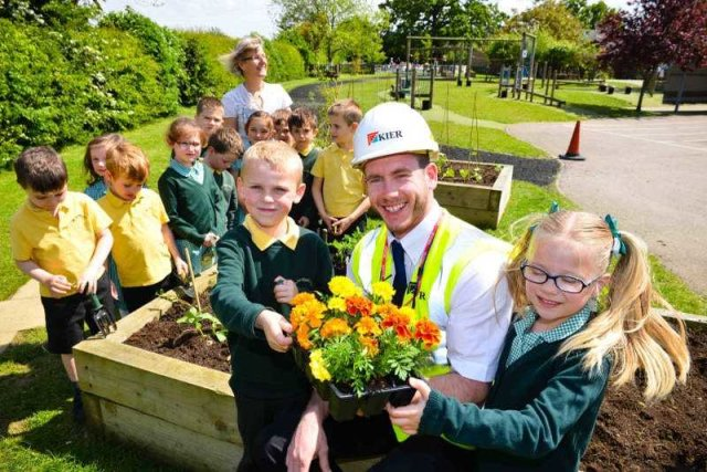 Pupils fill new planters thanks to Kier Living Eastern team