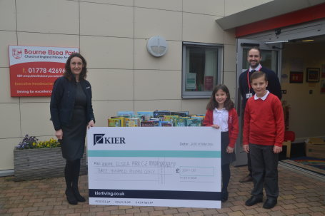 Kier Living donates £300 worth of books to  Elsea Park Primary School in Bourne